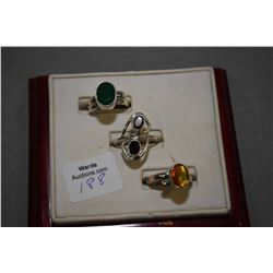 Sterling silver and gemstone rings including lab created emerald, ammonite and garnet