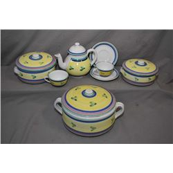 Glazed terracotta tableware including three lidded casserole dishes, teapot and two cups and saucers