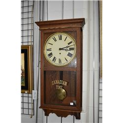 """Antique Arthur Pequegnant wall clock in oak and glass case, original """"Canadian Time"""" silk screen, wi"""