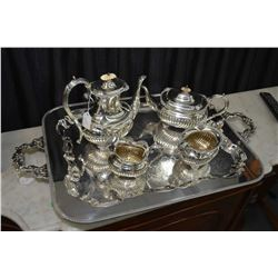 Birks sterling silver four piece tea service with coffee pot, teapot, cream and open sugar on a larg
