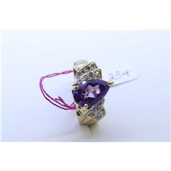Ladies 14kt yellow gold ring set with pear shaped amethyst gemstone and diamonds