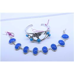 Two sterling silver bracelets including turquoise gemstone set cuff and a lapis gemstone style brace