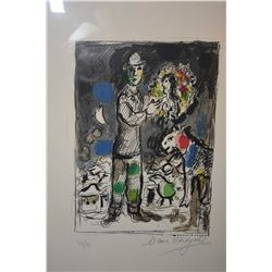 Framed limited edition coloured lithograph of a man holding a portrait of a woman signed by artist M