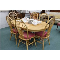 Modern center pedestal oak dining table with two insert leafs and six bend wood dining chairs marked