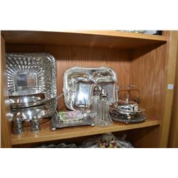 Shelf lot of collectible silver-plate including lidded casseroles, spooners, meat platter, three bra