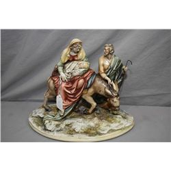 """An Italian made Borsato porcelain figure of Mary, Joseph and baby Jesus, 11"""" in height"""