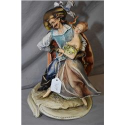 """An Italian made Borsato porcelain figure of a Zoro type character wooing a young woman, 13"""" in heigh"""