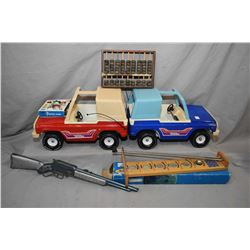 Large selection of vintage children's toys including two Tonka brand jeeps, one blue and one red, Ja