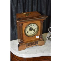 """Antique chiming wooden cased mantle clock with paper label """"John Clark & Son, Watch makers and Jewel"""