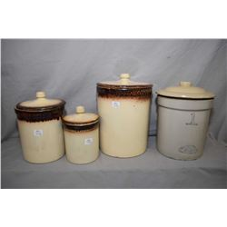 Set of three Medalta potteries lidded crocks in graduated sizes and a one gallon Alberta Potteries l