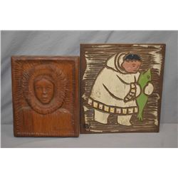 """Two hand carved wooden plaques including Inuit figure with fish by J. Gruter on mahogany, 12"""" X 11"""""""
