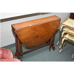 Antique gate leg table with bobbin supports and stretchers, fitted with original porcelain castors