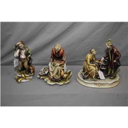 Three Italian made Borsato porcelain figures including elderly couple with tea table, lady peeling p
