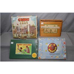Four vintage child's building sets including Canadian Logs, Kiddyclock, Dinky builder etc., all with