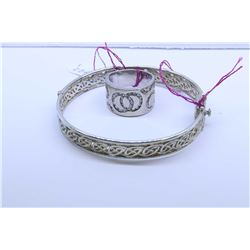"""Hinged silver Celtic motif bracelet (no markings seen"""" and a sterling ring set with diamante style g"""