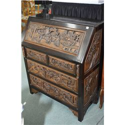 Oriental motif fall front bureau with four drawers in base, heavily carved full figural panels on fr