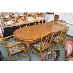 Quality mahogany French provincial dining table with skirted leaf, six chairs including one carver a