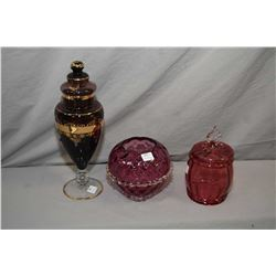 Antique cranberry glass biscuit barrel with applied colourless handle, amethyst glass rose bowl and