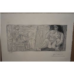 Framed limited edition etching by Picasso of the artist at work in his studio, pencil signed 74/750,