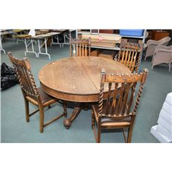 Antique center pedestal quarter cut oak round dining table plus four dining chairs with tapered cent