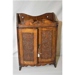 Antique oak wall mount of desk top pipe tobacconist cabinet including pipe hangers, two small drawer