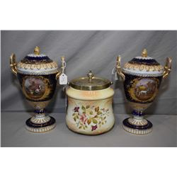 Two matching Vienna lidded porcelain double handled urns with hand painted enamelled cameos and gild