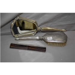 Three piece International sterling dresser set including bevelled hand mirror, hairbrush and comb