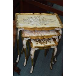 Vintage channel back loveseat with decorative show wood and a set of three painted nesting tables