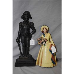 """Two cast metal doorstops including Napoleon figure 15"""" and a young girl with flower basket"""