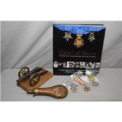 """Selection of collectibles including three vintage war medals, hardcover books """"Medal of Honour- port"""