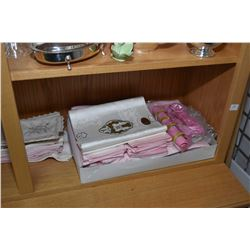 Selection of vintage table linens including Irish linen, damask tablecloths, embroidered cloth, croc
