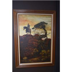 Large framed oil on canvas painting of a mounted cowboy with drawn rifle on a rocky ridge, no artist