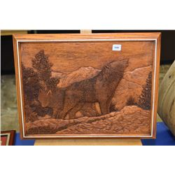 Simulated carved wood wall art of a wolf on a mountain scene
