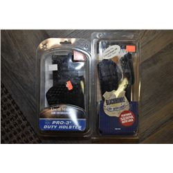 Two new in package right hand holsters including Uncle Mikes size 18, 3518-5 and a BlackHawk Smith &