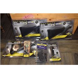 Selection of brand new in package Mossberg model 500 shot gun accessories including three item no. 9