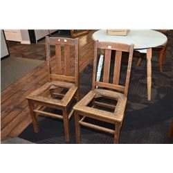 Pair of matching antique quarter cut oak slat back side chairs, both missing seat pads