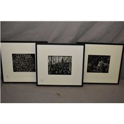 Three framed black and white block prints
