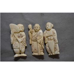 """Three vintage carved ivory figures, each approximately 2"""" in height"""