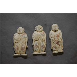"""Three vintage carved ivory netsukes, each approximately 2"""" in height"""