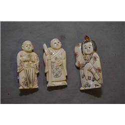 """Three vintage carved ivory figures including one 2"""" netsuke and a pendant/brooch and a 1 3/4"""" carved"""