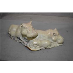 """Large soapstone carving of three hippopotamus, 21"""" in length"""