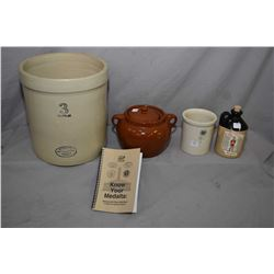 Three pieces of Medalta stoneware including a quarter gallon crock, a three gallon crock, lidded bea