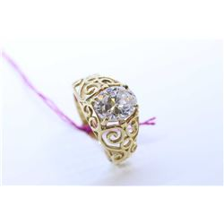 Ladies 10kt yellow gold filigree ring set with oval cut simulated diamond gemstone