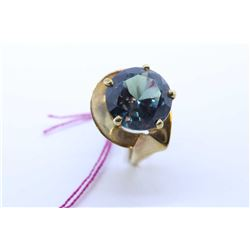 Ladies 10kt yellow gold ring set with simulated alexandrite gemstone stone