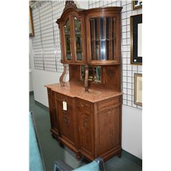Antique quarter cut oak sideboard with three carved raised panel doors in base plus three drawers, m