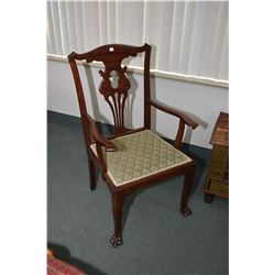 Antique open arm side chair with upholstered seat and carved paw feet
