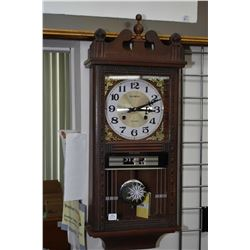Wall mounted 31 day chiming clock made by Olympia with day and date display