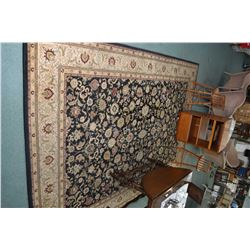Wool area carpet with geometric floral design including in multi border with black background and hi