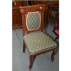 Antique Canadiana side chair with decorative carved back and upholstered seat and back