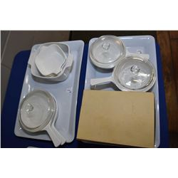 Selection of Corning ware cookware including three round lidded casseroles, three small and one larg